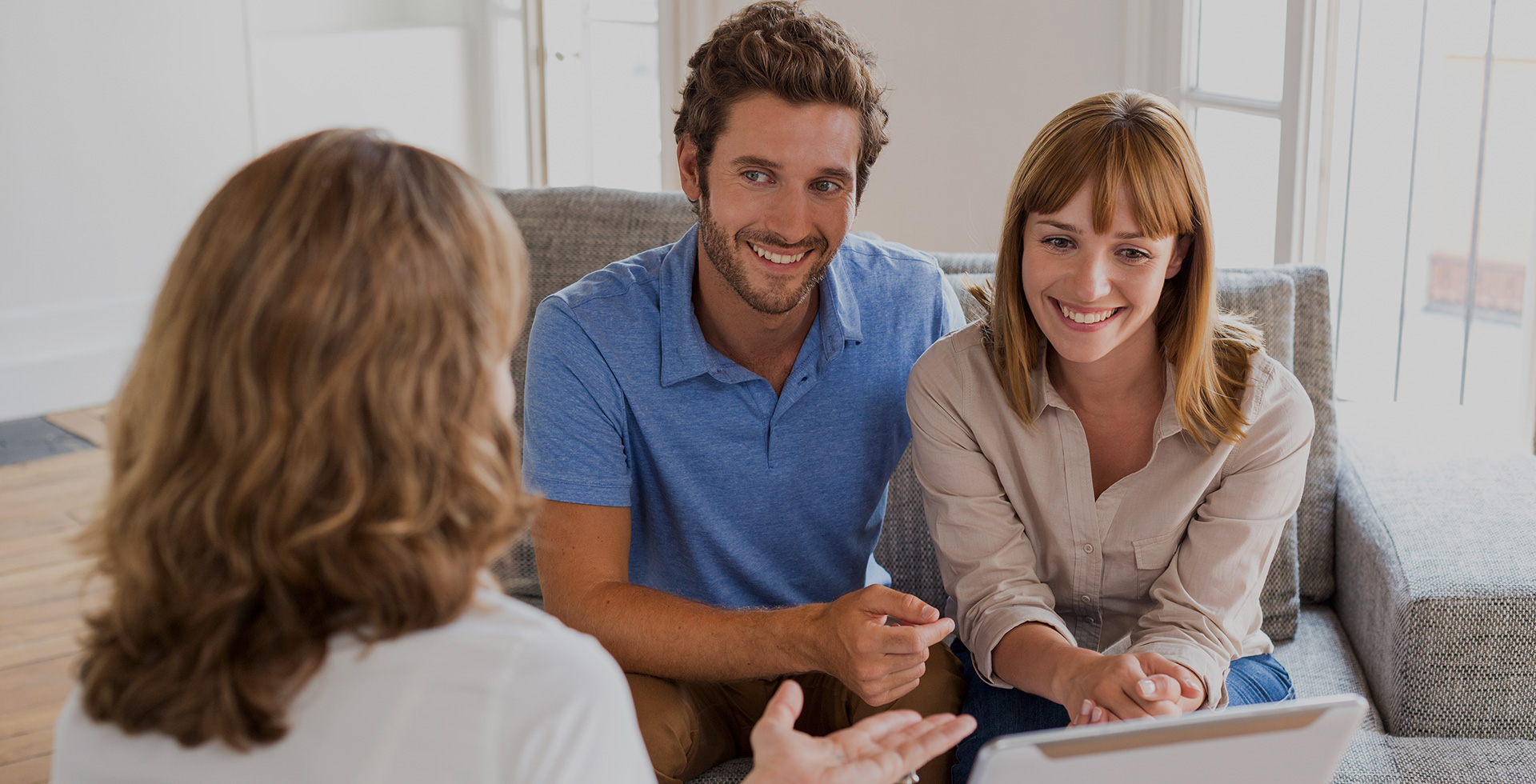 Young couple speaking with insurance agent
