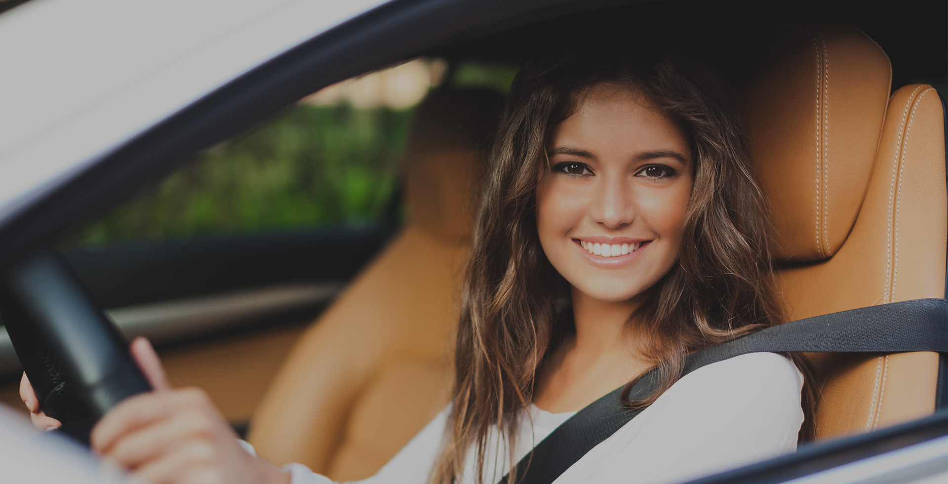 Woman in driver seat of car